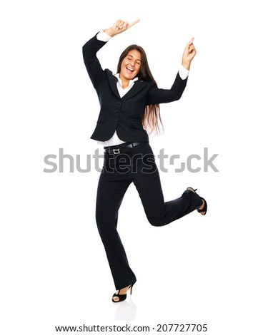 Business woman in a black suit dancing is happy cheerful.    Isolated on a white background. - stock photo