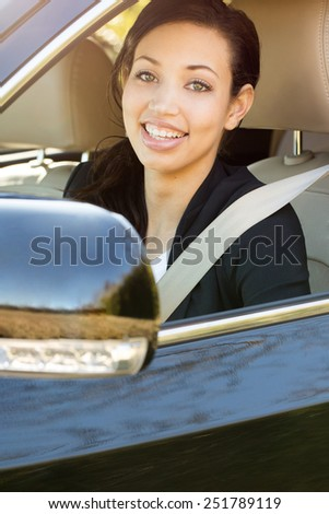 Business woman in a car - stock photo