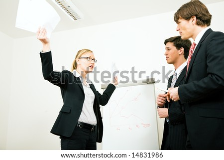 Business woman in a defensive position - stock photo