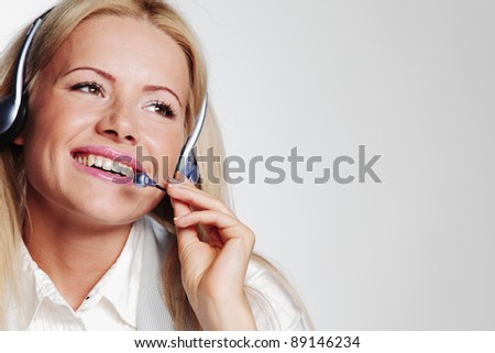 business woman in a headset on a gray background