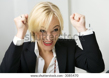 Business woman in a suit expressing joy or being successful