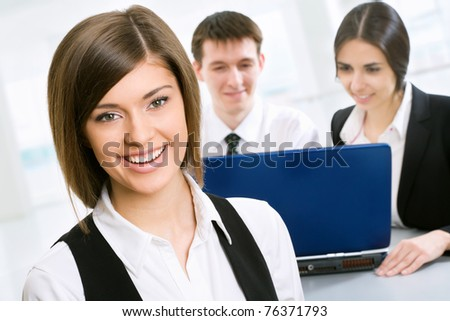Business woman in an office environment - stock photo