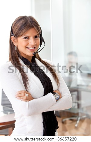 Business woman in an office with headset - stock photo
