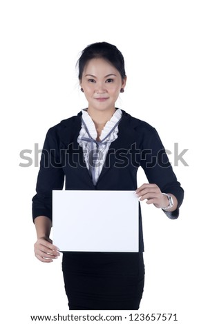 Business woman in black suit holding a blank sign board, Isolated on white background. Model is Asian woman. - stock photo