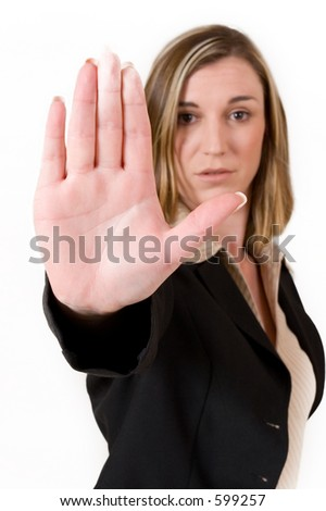Business woman in black suit holing up hand.  Shallow DOF, hand in focus, eyes out of focus - stock photo