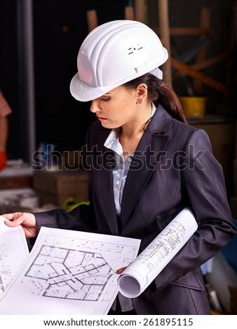 Business woman in builder helmet indoor. - stock photo