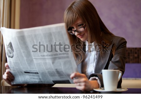 business woman in cafe read newspaper - stock photo