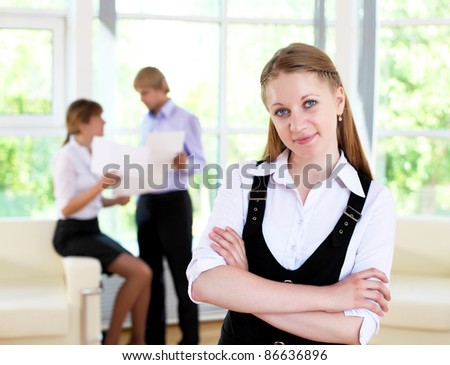 business woman in office and collegues on background - stock photo