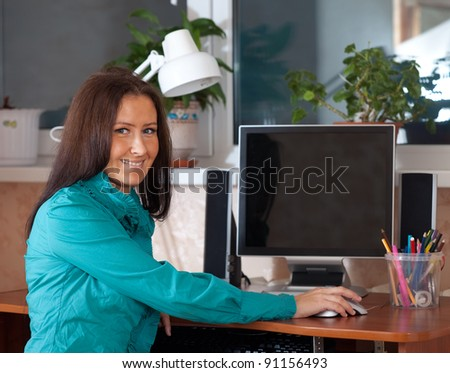 business woman in office using computer - stock photo