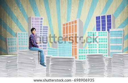Business woman in suit standing on pile of documents and looking at watch with sketched cityscape view on background. Mixed media.