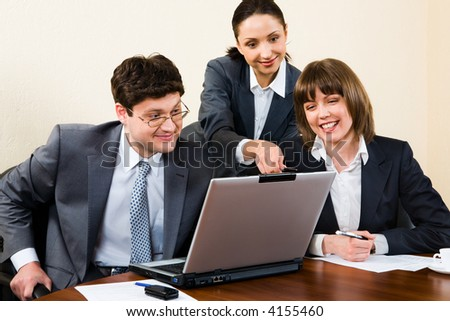 Business woman is explaining the correct way of analysis to her colleagues in  the office - stock photo