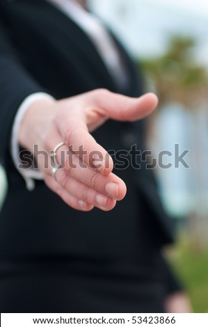 Business woman is going to shake hands - stock photo