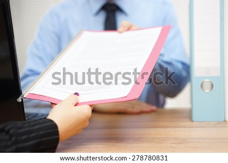 business woman is passing document to manager - stock photo