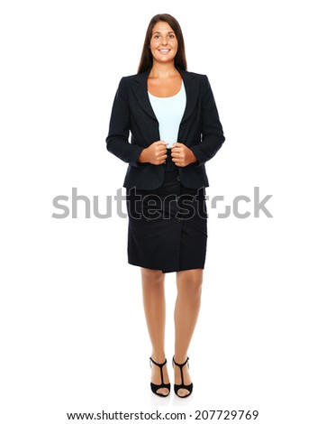 Business woman is standing full length looking confident.   Isolated on a white background.