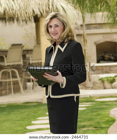 business woman is standing with binder - stock photo