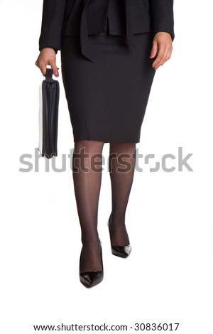 Business woman is walking with briefcase. - stock photo