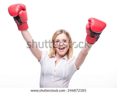 Business woman is wearing boxing gloves and business suit on the white background.