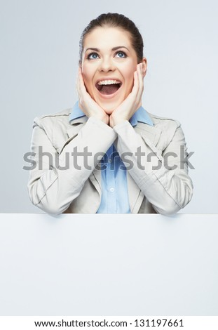 Business woman isolated portrait . Smiling woman show  big blank board . Close up female face portrait with arms on blank card. Emotion face . - stock photo