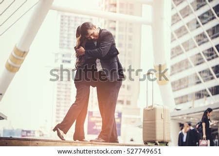 business woman Jump embracing her husband after bonding from business trip at city. Young couple worker. Young businessman in city.