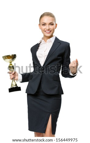 Business woman keeping golden cup and fist up gesturing, isolated on white. Concept of victory and success