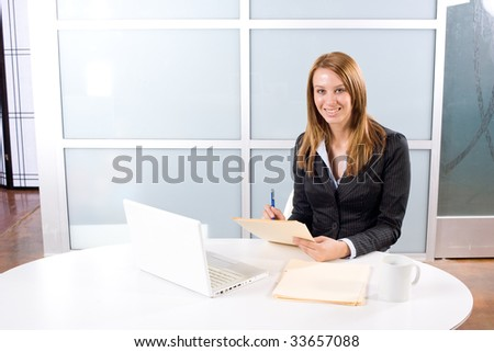 Business woman laptop in modern office - stock photo