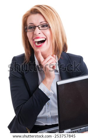 Business woman laughing hard while holding a laptop - stock photo