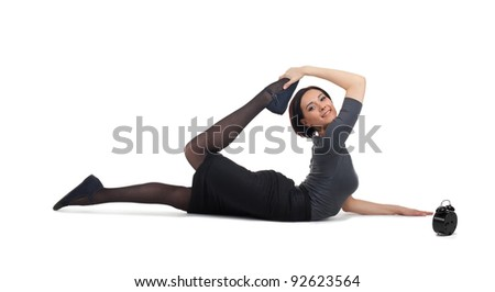 business woman lay in yoga pose with clock - stock photo