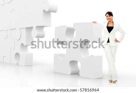 business woman leaning a puzzle isolated over a white background - solutions - stock photo