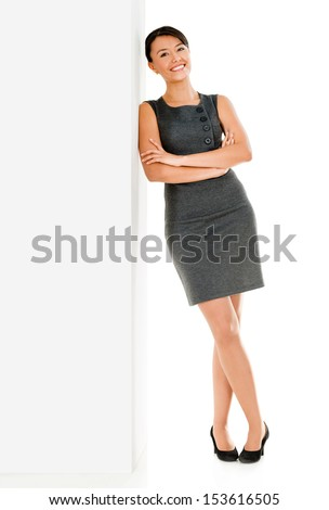 Business woman leaning against the wall - isolated over white background  - stock photo