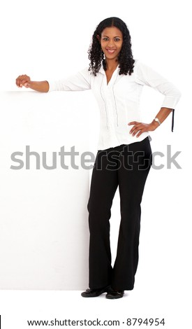 business woman leaning on a banner add isolated over a white background - stock photo