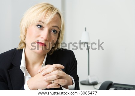 Business woman listening looking rather pleased