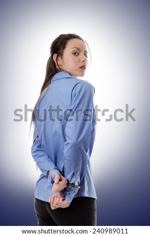 business woman locked up with her hand in handcuff - stock photo