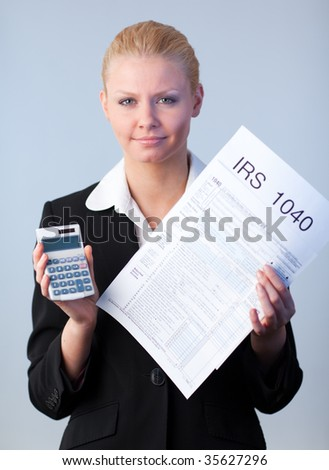 Business woman looking at filling in tax returns - stock photo