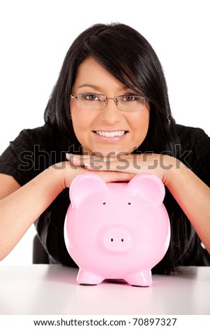 business woman looking at her savings in a piggy bank - isolated - stock photo