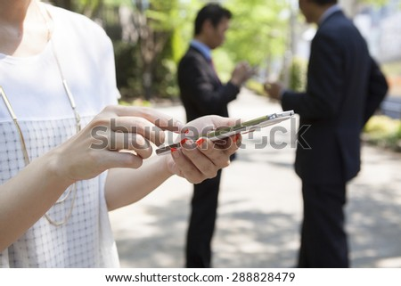 Business woman looking at her smartphone