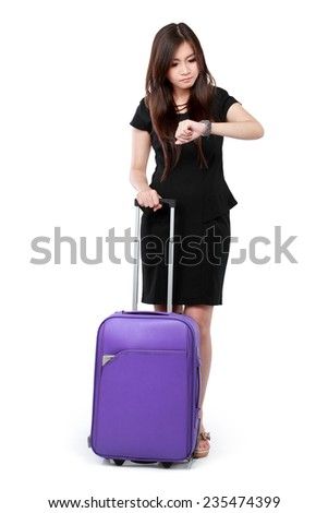 Business woman looking at the time and ready for travel. isolated over white background - stock photo
