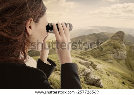 business woman looking the future whit a binocular - stock photo