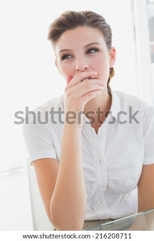 Business woman looking very tired and yawning - stock photo