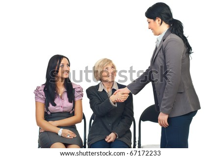 Business woman make acquaintance with a senior woman at conference isolated on white background
