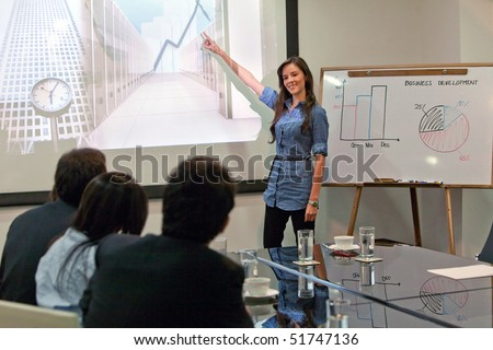Business woman making a presentation at the office - stock photo