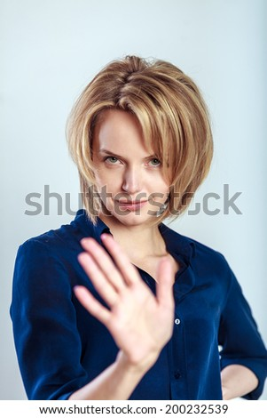 business woman making stop hand sign. studio photoshoot - stock photo