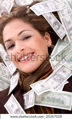 business woman millionaire with money around her face