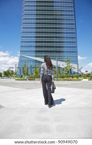 business woman next to skyscrapers in Madrid city Spain - stock photo