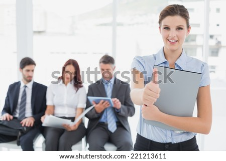 Business woman offering a handshake to the camera - stock photo