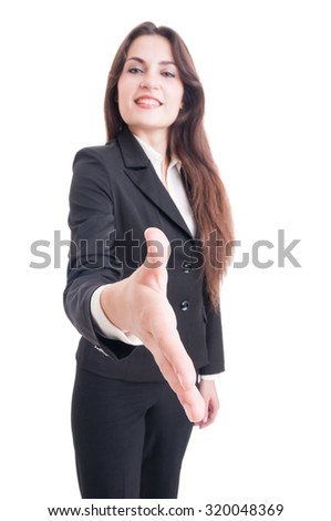 Business woman offering handshake with selective focus on hand isolated on white background
