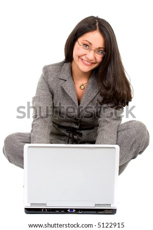 business woman on a laptop on the floor over a white background - stock photo