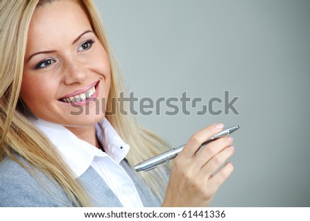 business woman on gray background  pen in hands - stock photo