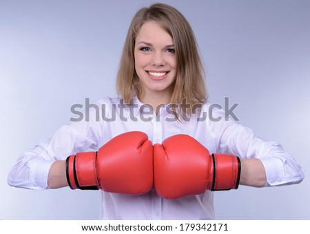 Business woman on grey background - stock photo