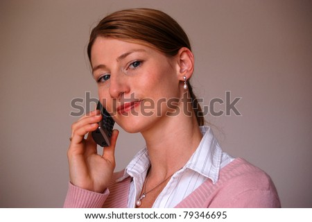 Business woman on the phone smiling over a brown background - stock photo
