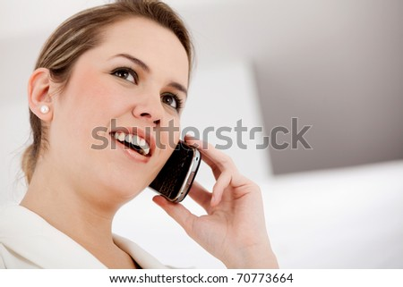 Business woman on the phone taking a call - stock photo
